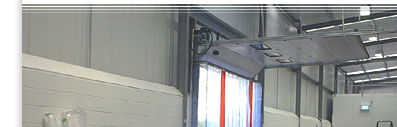(top half) PVC curtains hanging in a warehouse door