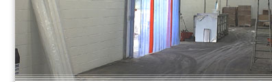(bottom half) PVC curtains hanging in a warehouse door