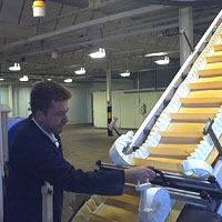 man fixing a conveyor