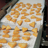 hash browns on a conveyor belt